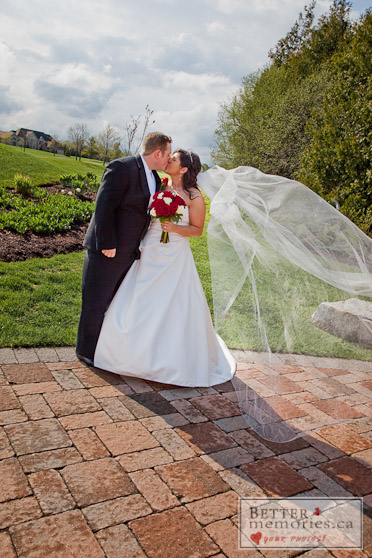 Bride and Groom Kissing on a Walkway by the Golf Course