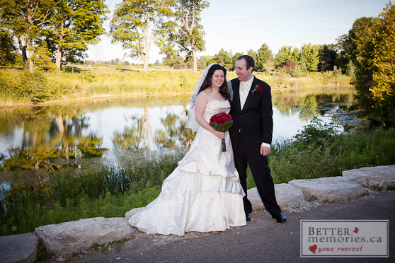 Bride and Groom on a Pathway by the Pond