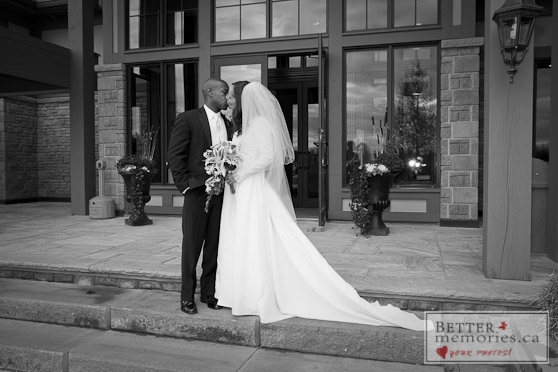 Bride and Groom Kissing in front of the Clubhouse