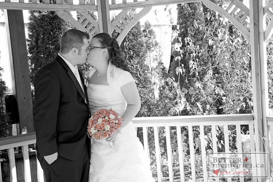 Bride and Groom Kissing in the Gazebo