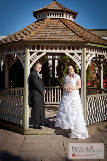 Bride and Groom Standing in the Gazebo